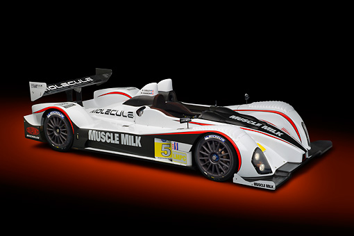 AUT 13 RK0386 01 © Kimball Stock 2012 Muscle Milk LMPC Race Car White, Black And Red 3/4 Front View In Studio