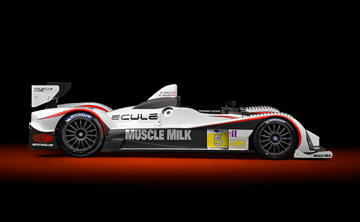 AUT 13 RK0387 01 © Kimball Stock 2012 Muscle Milk LMPC Race Car White, Black And Red Profile View In Studio