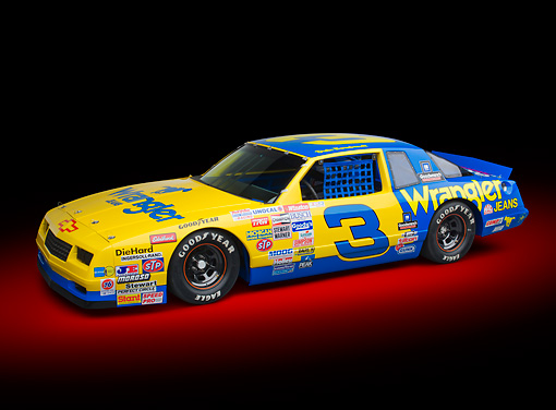 AUT 13 RK0389 01 © Kimball Stock 1987 Chevrolet Monte Carlo Stock Car Blue And Yellow 3/4 Front View In Studio
