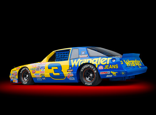 AUT 13 RK0392 01 © Kimball Stock 1987 Chevrolet Monte Carlo Stock Car Blue And Yellow 3/4 Rear View In Studio