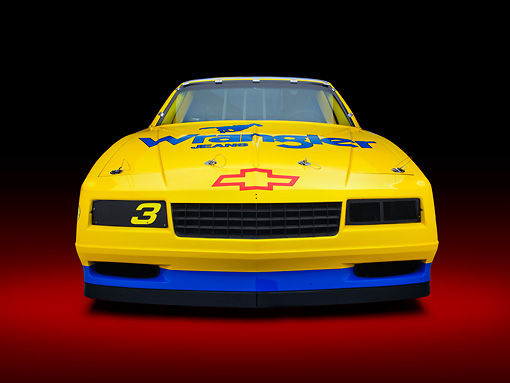 AUT 13 RK0395 01 © Kimball Stock 1987 Chevrolet Monte Carlo Stock Car Blue And Yellow Front View In Studio