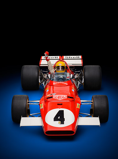 AUT 13 RK0422 01 © Kimball Stock 1970 Ferrari 312B Race Car Red With Driver Front View In Studio