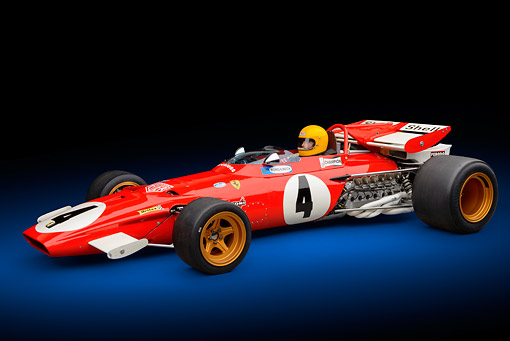 AUT 13 RK0424 01 © Kimball Stock 1970 Ferrari 312B Race Car Red With Driver 3/4 Side View In Studio