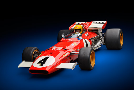 AUT 13 RK0427 01 © Kimball Stock 1970 Ferrari 312B Race Car Red With Driver 3/4 Front View In Studio
