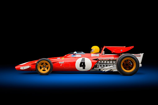 AUT 13 RK0429 01 © Kimball Stock 1970 Ferrari 312B Race Car Red With Driver Profile View In Studio
