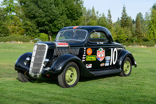 AUT 13 RK0431 01 © Kimball Stock 1935 Ford Nascar Coupe #10 Black 3/4 Front View On Grass By Trees