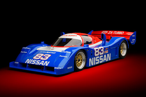 AUT 13 RK0432 01 © Kimball Stock 1992 Nissan GTP ZX-Turbo Race Car Blue And Red 3/4 Front View In Studio