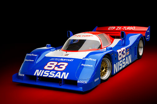 AUT 13 RK0433 01 © Kimball Stock 1992 Nissan GTP ZX-Turbo Race Car Blue And Red 3/4 Front View In Studio