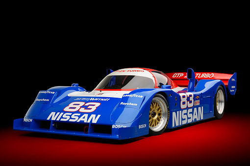 AUT 13 RK0434 01 © Kimball Stock 1992 Nissan GTP ZX-Turbo Race Car Blue And Red 3/4 Front View In Studio