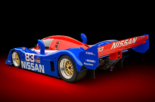 AUT 13 RK0435 01 © Kimball Stock 1992 Nissan GTP ZX-Turbo Race Car Blue And Red 3/4 Rear View In Studio
