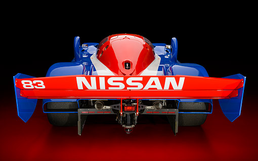 AUT 13 RK0437 01 © Kimball Stock 1992 Nissan GTP ZX-Turbo Race Car Blue And Red Rear View In Studio