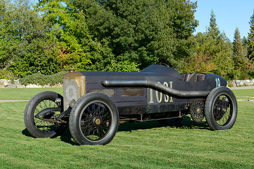 AUT 13 RK0439 01 © Kimball Stock 1913 Cottin & Desgouttes Race Car Black 3/4 Front View On Grass By Trees