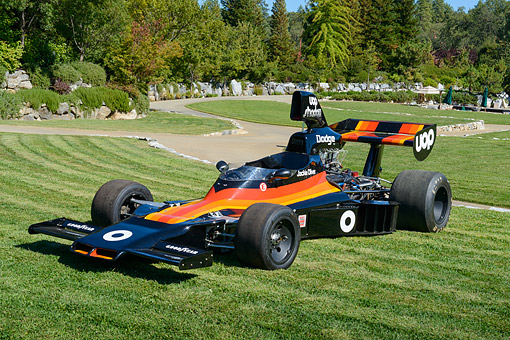 AUT 13 RK0440 01 © Kimball Stock Dodge Jackie Oliver Race Car Black And Orange 3/4 Front View On Grass By Trees
