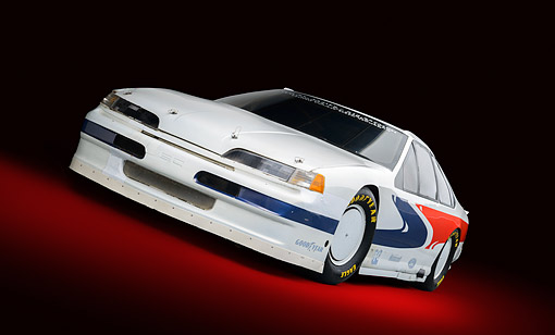 AUT 13 RK0441 01 © Kimball Stock 1988 Ford Thunderbird Race Car White With Graphics 3/4 Front View In Studio