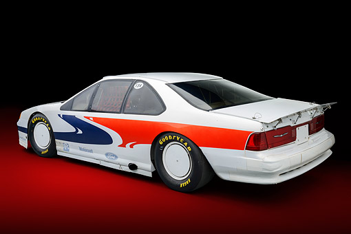 AUT 13 RK0444 01 © Kimball Stock 1988 Ford Thunderbird Race Car White With Graphics 3/4 Rear View In Studio
