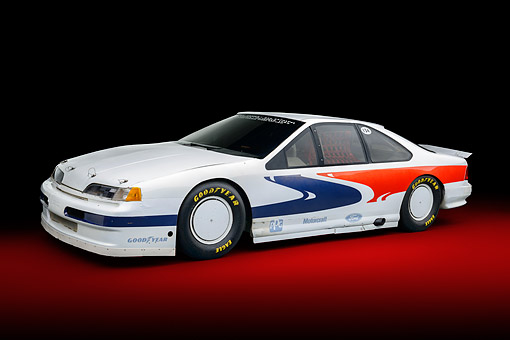 AUT 13 RK0446 01 © Kimball Stock 1988 Ford Thunderbird Race Car White With Graphics 3/4 Side View In Studio