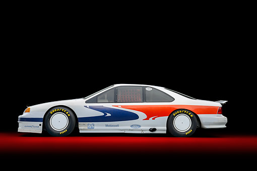 AUT 13 RK0447 01 © Kimball Stock 1988 Ford Thunderbird Race Car White With Graphics Profile View In Studio
