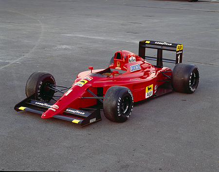 AUT 13 RK0007 05 © Kimball Stock 1990 Red Formula 1-641 3/4 Front View On Pavement