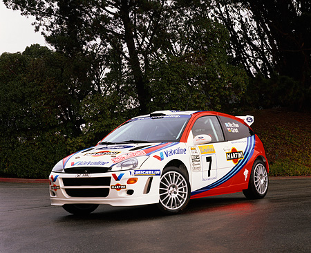 AUT 13 RK0030 02 © Kimball Stock 2000 Ford Focus Rally Racing Car 3/4 Front View On Pavement