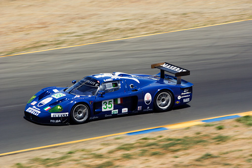 AUT 13 RK0060 01 © Kimball Stock Maserati MC12 GTI Blue Race Car 3/4 Front View On Track