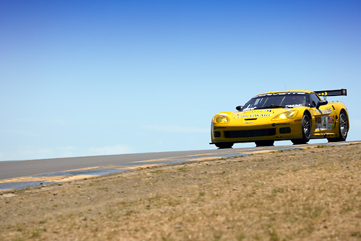 AUT 13 RK0061 01 © Kimball Stock Chevrolet Corvette C6-R Yellow Race Car On Track 3/4 Front View