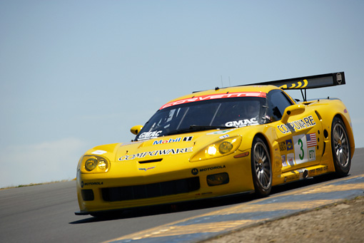 AUT 13 RK0063 01 © Kimball Stock Chevrolet Corvette C6-R Yellow Race Car 3/4 Front View On Track