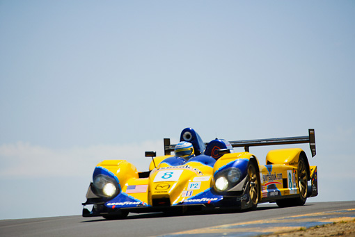 AUT 13 RK0066 01 © Kimball Stock Mazda Courage P2 Yellow Race Car 3/4 Front View On Track