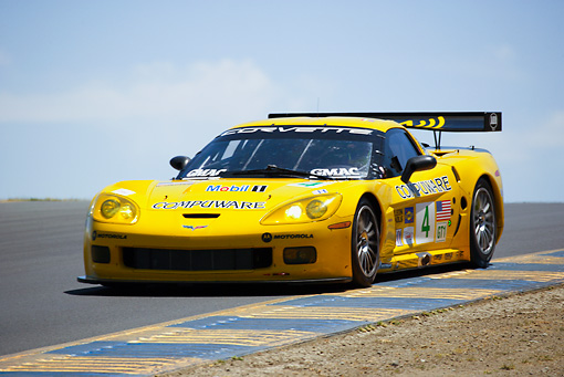 AUT 13 RK0068 01 © Kimball Stock Chevrolet Corvette C6-R Yellow Race Car 3/4 Front View On Track