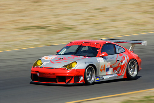 AUT 13 RK0076 01 © Kimball Stock Porsche 911 GT3 RSR Red Race Car 3/4 Side View On Track