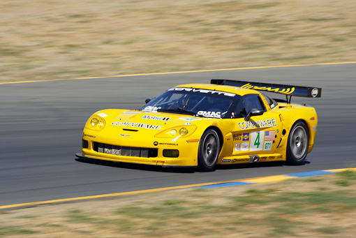 AUT 13 RK0079 01 © Kimball Stock Chevrolet Corvette C6-R Yellow Race Car 3/4 Front View On Track