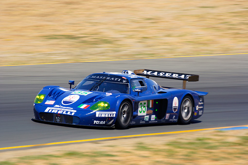 AUT 13 RK0080 01 © Kimball Stock Maserati MC12 GTI Blue Race Car 3/4 Side View On Track