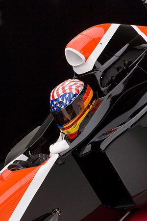 AUT 13 RK0143 01 © Kimball Stock 2006 Mazda Pro Formula Black Orange And White Close Up With Driver Studio