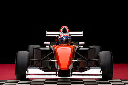 AUT 13 RK0149 01 © Kimball Stock 2006 Mazda Pro Formula Black Orange And White Head On View With Driver Studio