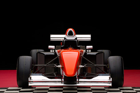 AUT 13 RK0150 01 © Kimball Stock 2006 Mazda Pro Formula Black Orange And White Head On View Studio