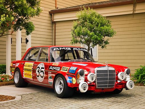 AUT 13 RK0195 01 © Kimball Stock 1971 Mercedes-Benz 300 SEL 6.8 AMG Race Car Red Sedan 3/4 Front View On Pavement
