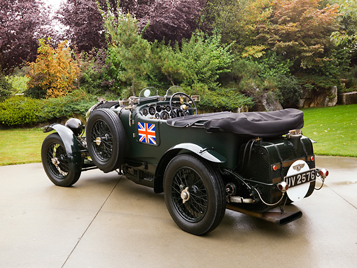 AUT 13 RK0204 01 © Kimball Stock 1929 Bentley Birkin Team Car Dark Green Rear 3/4 View On Pavement By Grass Trees