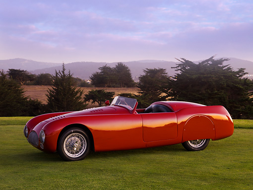 AUT 13 RK0214 02 © Kimball Stock 1947 Cisitalia 202 SMM Spider Nuvolari Red 3/4 Front View On Grass By Trees Mountains Sky