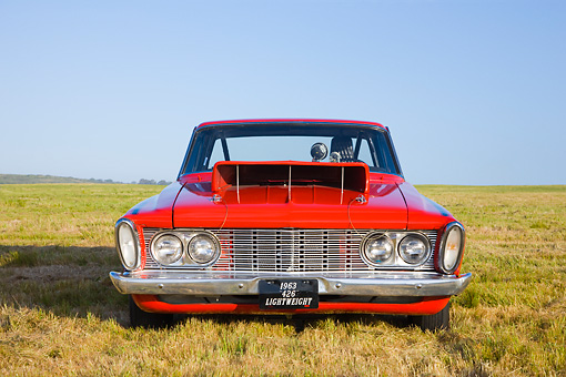 AUT 13 RK0238 01 © Kimball Stock 1963 Plymouth Savoy Super Stock Dragster Red Head On View In Field