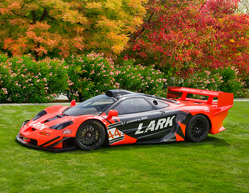 AUT 13 RK0259 01 © Kimball Stock 1997 McLaren F1 GTR Longtail Red And Black 3/4 Front View On Lawn