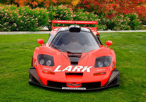 AUT 13 RK0262 01 © Kimball Stock 1997 McLaren F1 GTR Longtail Red And Black Front View On Lawn