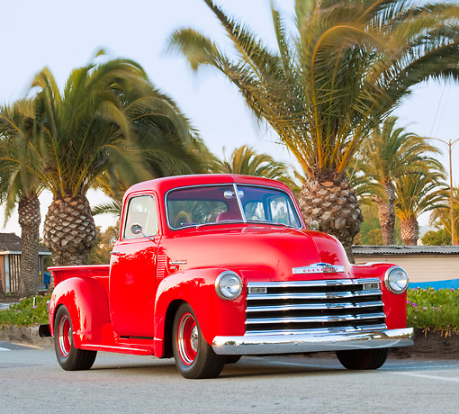 AUT 14 BK0034 01 © Kimball Stock 1951 Chevrolet 3100 Pickup Truck Red 3/4 Front View On Pavement By Marina