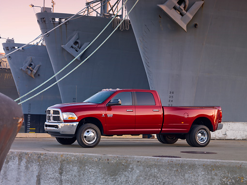 AUT 14 BK0050 01 © Kimball Stock 2010 Dodge Ram 3500 Pickup Truck Red 3/4 Side View On Dock By Ships