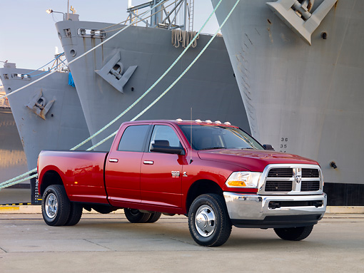 AUT 14 BK0051 01 © Kimball Stock 2010 Dodge Ram 3500 Pickup Truck Red 3/4 Front View On Dock By Ships