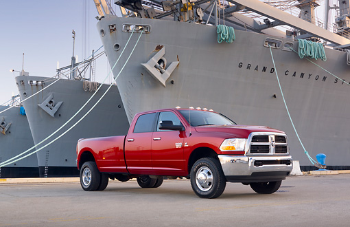 AUT 14 BK0052 01 © Kimball Stock 2010 Dodge Ram 3500 Pickup Truck Red 3/4 Front View On Dock By Ships