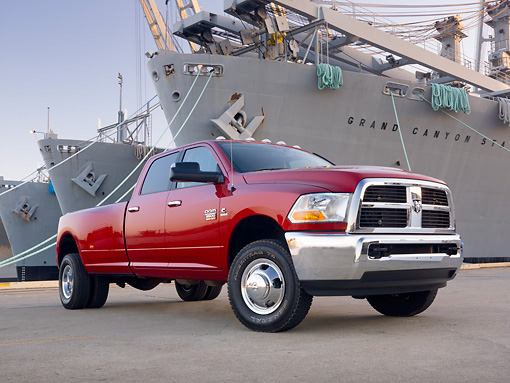 AUT 14 BK0053 01 © Kimball Stock 2010 Dodge Ram 3500 Pickup Truck Red 3/4 Front View On Dock By Ships