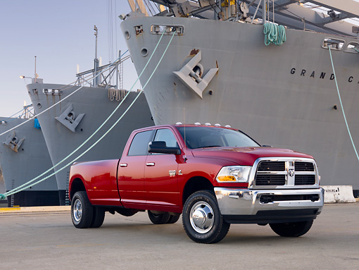 AUT 14 BK0054 01 © Kimball Stock 2010 Dodge Ram 3500 Pickup Truck Red 3/4 Front View On Dock By Ships