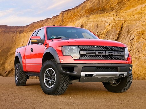 AUT 14 BK0062 01 © Kimball Stock 2011 Ford F-150 SVT Raptor Pickup Truck Red 3/4 Front View On Sand By Cliffs