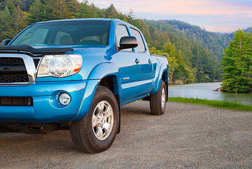 AUT 14 BK0073 01 © Kimball Stock 2011 Toyota Tacoma Double Cab Pickup Truck Blue 3/4 Front View On Gravel By River In Forest