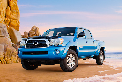 AUT 14 BK0074 01 © Kimball Stock 2011 Toyota Tacoma Double Cab Pickup Truck Blue 3/4 Front View On Beach