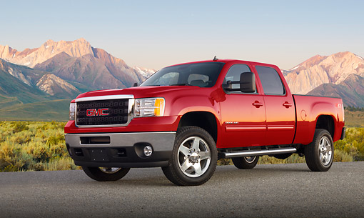 AUT 14 BK0083 01 © Kimball Stock 2012 GMC Sierra Pickup Truck Red 3/4 Front View On Pavement By Mountains